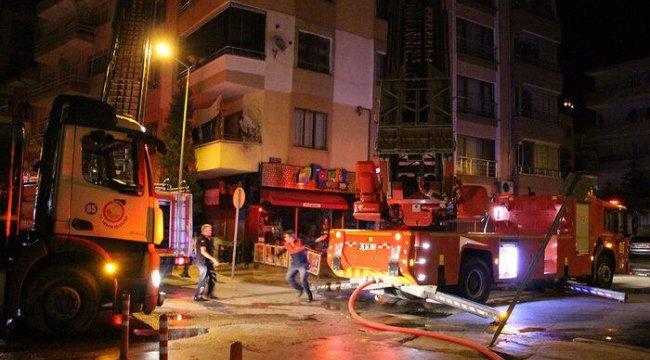 Amasya'da korkutan yangın! Balkondan hortumla müdahale etti